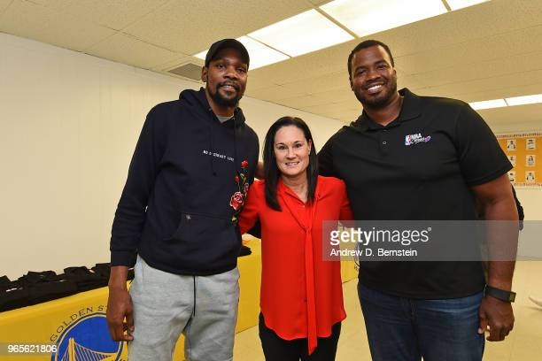 Kevin Durant of the Golden State Warriors Jennifer Azzi and Jason Collins pose for a photo during the 2018 NBA Finals Legacy Project NBA Cares on...
