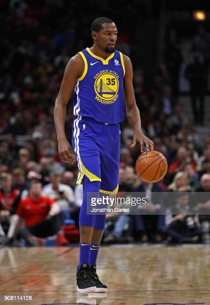 Kevin Durant of the Golden State Warriors lbrings the ball up the court against the Chicago Bulls at the United Center on January 17 2018 in Chicago...