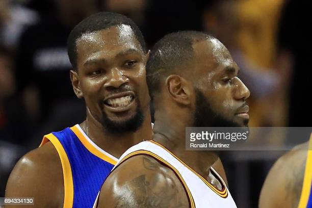 Kevin Durant of the Golden State Warriors looks at LeBron James of the Cleveland Cavaliers in the first quarter in Game 4 of the 2017 NBA Finals at...