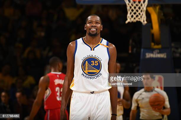 Kevin Durant of the Golden State Warriors looks on against the Los Angeles Clippers during a preseason game on October 4 2016 at Oracle Arena in...