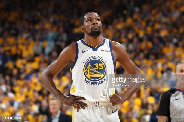 Kevin Durant of the Golden State Warriors looks on against the Houston Rockets during Game Five of the Western Conference Semifinals of the 2019 NBA...