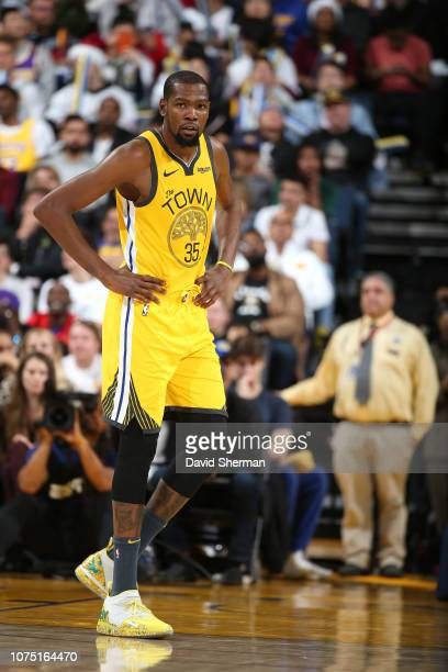 Kevin Durant of the Golden State Warriors looks on during a game against the Los Angeles Lakers on December 25 2018 at ORACLE Arena in Oakland...