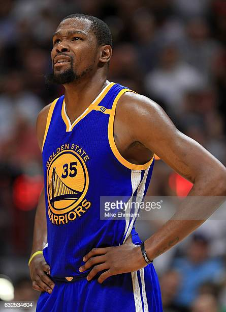 Kevin Durant of the Golden State Warriors looks on during a game against the Miami Heat at American Airlines Arena on January 23 2017 in Miami...