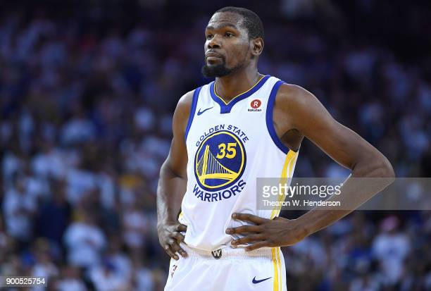 Kevin Durant of the Golden State Warriors looks on while there's a break in the action against the Cleveland Cavaliers late in the fouth quarter of...
