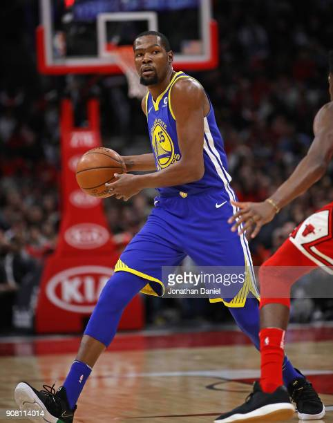 Kevin Durant of the Golden State Warriors looks to pass against the Chicago Bulls at the United Center on January 17 2018 in Chicago Illinois NOTE TO...