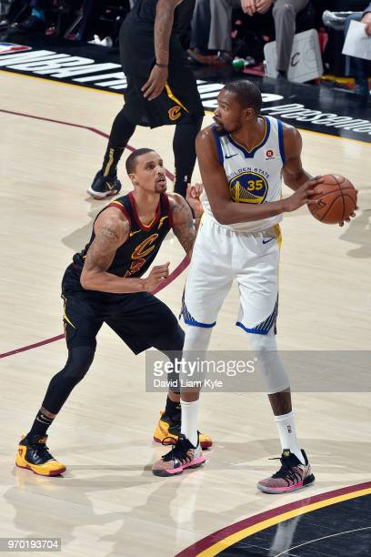 OH Kevin Durant of the Golden State Warriors looks to pass the ball during the game against George Hill of the Cleveland Cavaliers in Game Four of...
