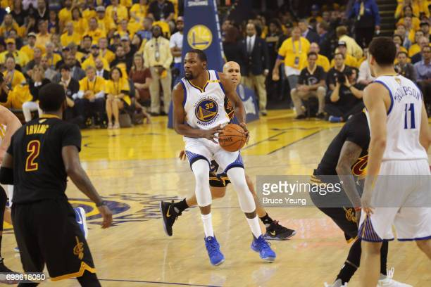 Kevin Durant of the Golden State Warriors looks to shoot a three point basket against the Cleveland Cavaliers in Game Five of the 2017 NBA Finals on...