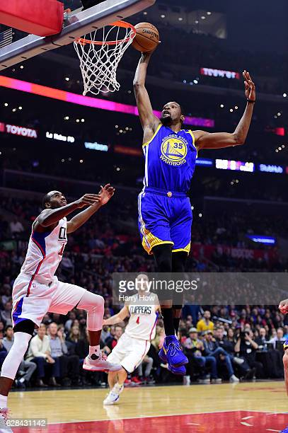 Kevin Durant of the Golden State Warriors misses a dunk in front of Luc Mbah a Moute of the LA Clippers during the first half at Staples Center on...