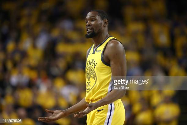 Kevin Durant of the Golden State Warriors motions towards the bench during their game against the LA Clippers during Game Two of the first round of...