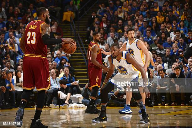 Kevin Durant of the Golden State Warriors plays defense against LeBron James of the Cleveland Cavaliers on January 16 2017 at ORACLE Arena in Oakland...