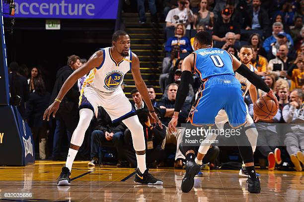 Kevin Durant of the Golden State Warriors plays defense against Russell Westbrook of the Oklahoma City Thunder during the game on January 18 2017 at...