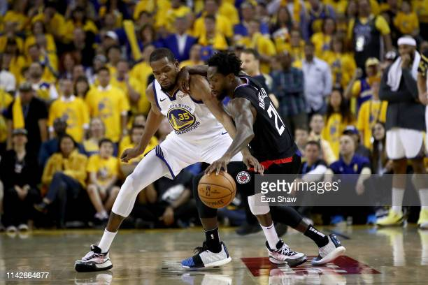 Kevin Durant of the Golden State Warriors plays defense on Patrick Beverley of the LA Clippers during Game One of the first round of the 2019 NBA...