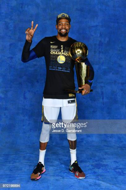 Kevin Durant of the Golden State Warriors poses for a portrait with the Larry O'Brien Championship trophy after defeating the Cleveland Cavaliers in...
