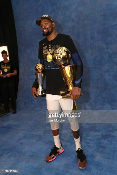 OH Kevin Durant of the Golden State Warriors poses for a portrait with the Larry O'Brien Championship trophy after defeating the Cleveland Cavaliers...