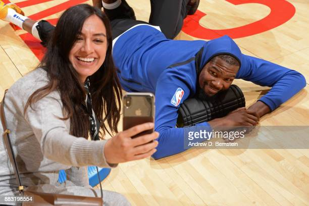 Kevin Durant of the Golden State Warriors poses for a 'selfie' with a fan before the game against the Los Angeles Lakers on November 29 2017 at...
