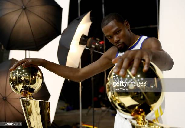 Kevin Durant of the Golden State Warriors poses with two Larry O'Brien NBA Championship Trophies and two NBA Finals MVP trophies during the Golden...
