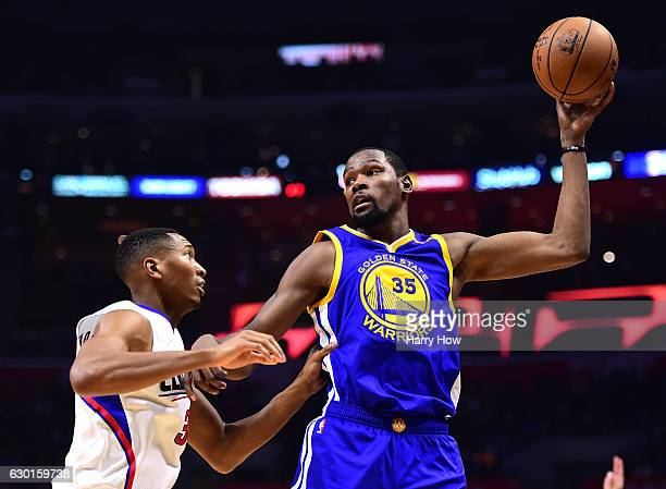 Kevin Durant of the Golden State Warriors post up Wesley Johnson of the LA Clippers at Staples Center on December 7 2016 in Los Angeles California...