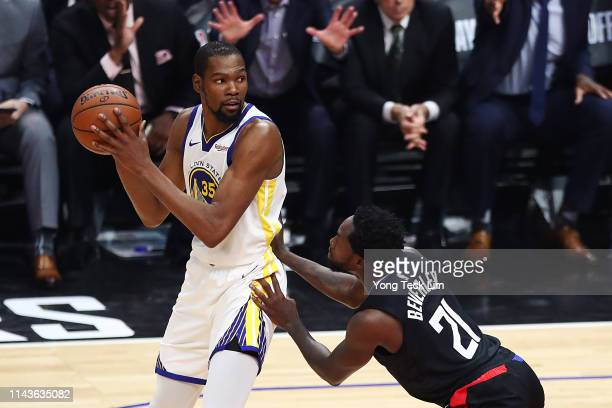 Kevin Durant of the Golden State Warriors posts up against Patrick Beverley of the Los Angeles Clippers during the first half at Staples Center on...