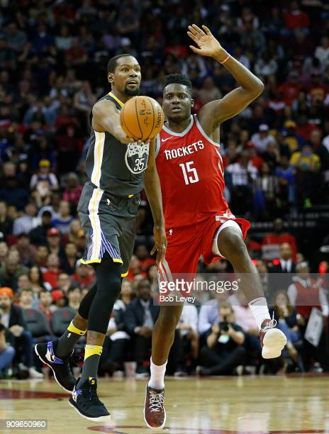 Kevin Durant of the Golden State Warriors puts up a shot as Clint Capela of the Houston Rockets defends at Toyota Center on January 20 2018 in...