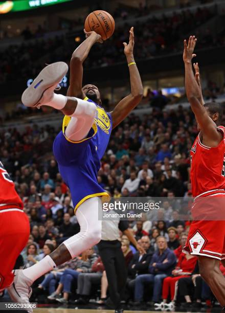 Kevin Durant of the Golden State Warriors puts up an off balance shot next to Cristiano Felicio of the Chicago Bulls at the United Center on October...