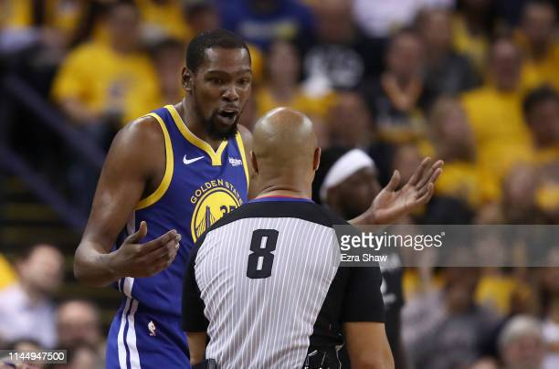 Kevin Durant of the Golden State Warriors questions a call by Marc Davis during their game against the LA Clippers during Game Five of the first...