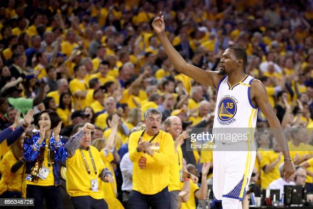 Kevin Durant of the Golden State Warriors reacts after a basket by Stephen Curry in Game 5 of the 2017 NBA Finals at ORACLE Arena on June 12 2017 in...