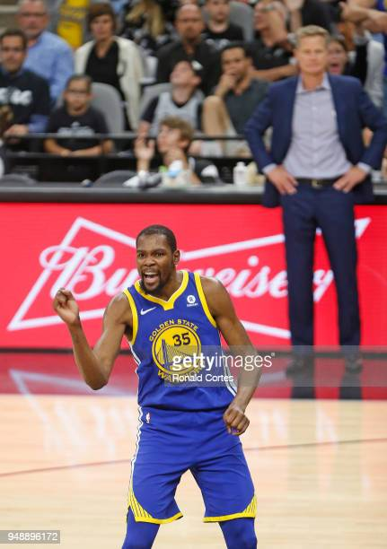 Kevin Durant of the Golden State Warriors reacts after a Klay Thompson of the Golden State Warriors basket against the San Antonio Spurs at ATT...