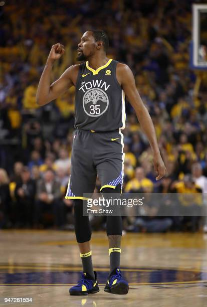 Kevin Durant of the Golden State Warriors reacts after Andre Iguodala of the Golden State Warriors made a threepoint basket against the San Antonio...