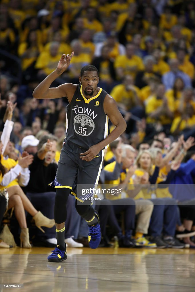 Kevin Durant #35 of the Golden State Warriors reacts after he made a three-point basket against the San Antonio Spurs during Game 2 of Round 1 of the 2018 NBA Playoffs at ORACLE Arena on April 16, 2018 in Oakland, California.