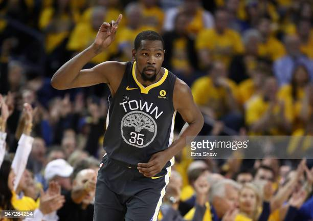 Kevin Durant of the Golden State Warriors reacts after he made a threepoint basket against the San Antonio Spurs during Game 2 of Round 1 of the 2018...