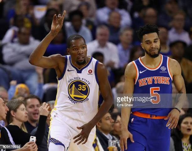 Kevin Durant of the Golden State Warriors reacts after making a basket over Courtney Lee of the New York Knicks at ORACLE Arena on January 23 2018 in...