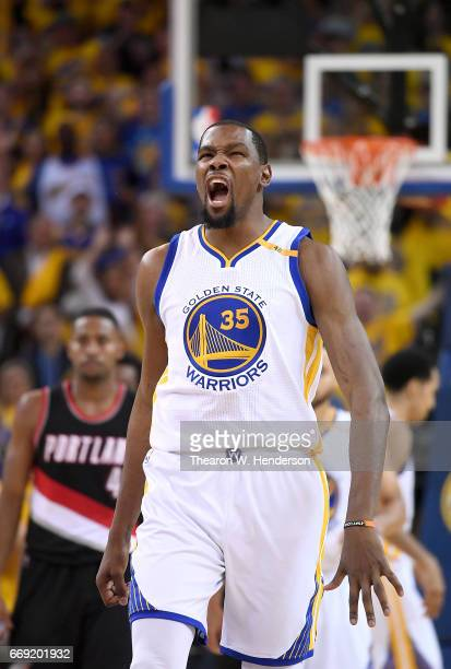 Kevin Durant of the Golden State Warriors reacts after they make a defensive stop against the Portland Trail Blazers in the fourth quarter during...