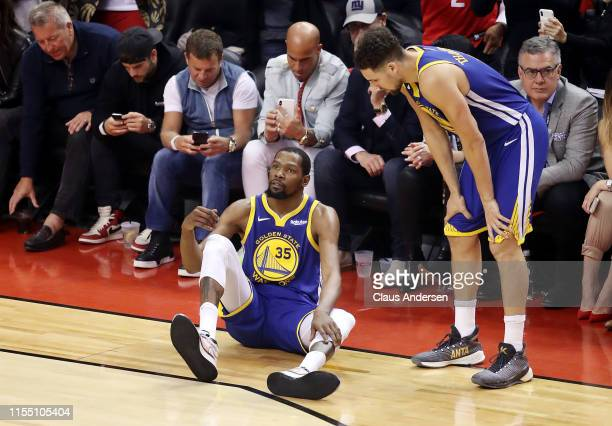Kevin Durant of the Golden State Warriors reacts against the Toronto Raptors in the first half during Game Five of the 2019 NBA Finals at Scotiabank...