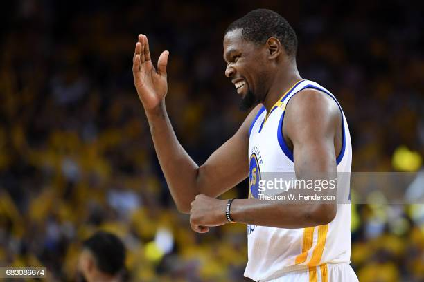 Kevin Durant of the Golden State Warriors reacts to a basket against the San Antonio Spurs during Game One of the NBA Western Conference Finals at...