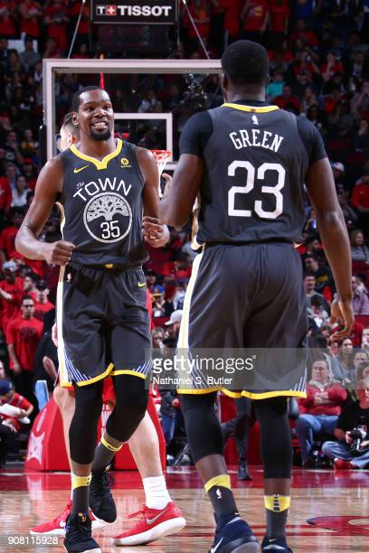 Kevin Durant of the Golden State Warriors reacts to a play during the game against the Houston Rockets on January 20 2018 at the Toyota Center in...