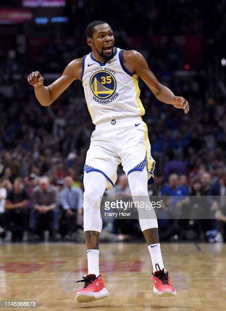 Kevin Durant of the Golden State Warriors reacts to his three pointer in the first half against the LA Clippers during Game Six of Round One of the...