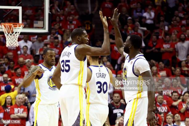 Kevin Durant of the Golden State Warriors reacts with Draymond Green of the Golden State Warriors in the fourth quarter against the Houston Rockets...