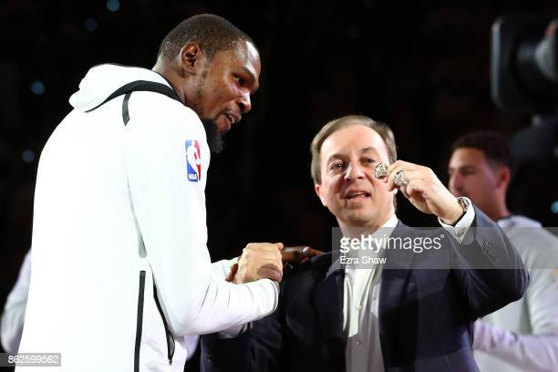 Kevin Durant of the Golden State Warriors receives his 2017 NBA Championship ring from team owner Joe Lacob prior to their NBA game against the...