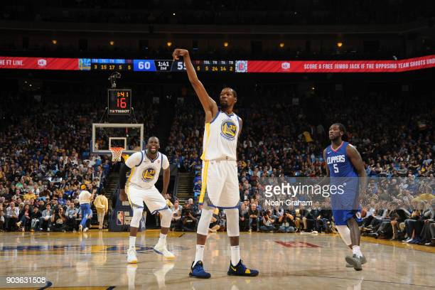 Kevin Durant of the Golden State Warriors scores his 20000th career point during the game against the LA Clippers on January 10 2018 at ORACLE Arena...