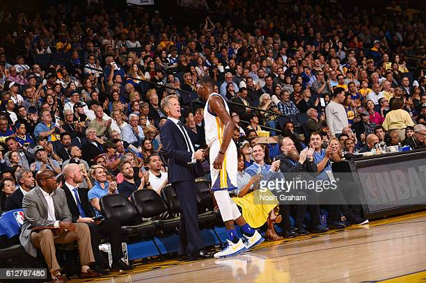 Kevin Durant of the Golden State Warriors shakes hands with head coach Steve Kerr of the Golden State Warriors during the game against the Los...