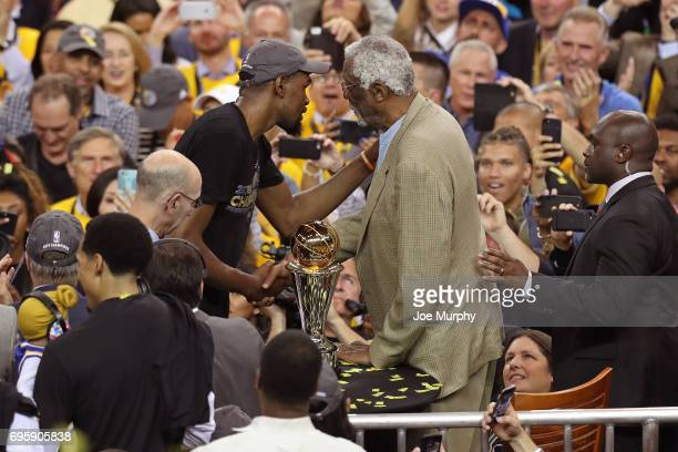 Kevin Durant of the Golden State Warriors shakes hands with NBA legend Bill Russell during the postgame celebration after Game Five of the 2017 NBA...