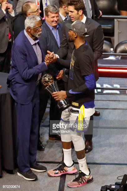Kevin Durant of the Golden State Warriors shakes NBA Legend Bill Russell hand after winning the Bill Russell Finals MVP Trophy in Game Four of the...