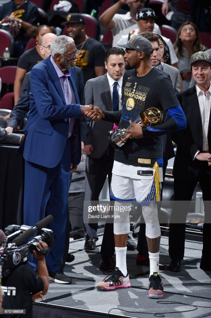 OH - Kevin Durant #35 of the Golden State Warriors shakes the hand of Bill Russell as he accepts the Bill Russell NBA Finals Most Valuable Player Trophy after Game Four of the 2018 NBA Finals on June 8, 2018 at Quicken Loans Arena in Cleveland, Ohio.