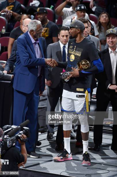 OH Kevin Durant of the Golden State Warriors shakes the hand of Bill Russell as he accepts the Bill Russell NBA Finals Most Valuable Player Trophy...