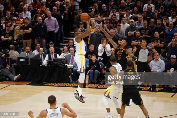 Kevin Durant of the Golden State Warriors shoots a 3point jumper with 515 seconds remaining against the Cleveland Cavaliers during Game Three of the...
