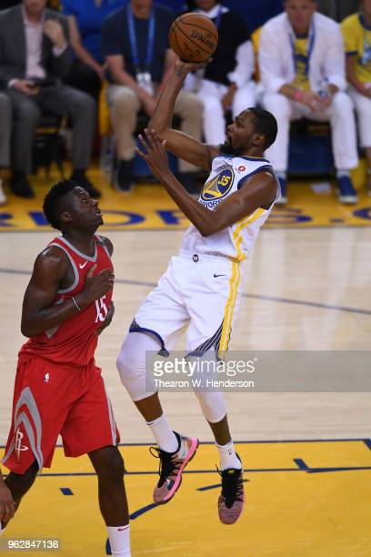 Kevin Durant of the Golden State Warriors shoots a basket against Clint Capela of the Houston Rockets during Game Six of the Western Conference...
