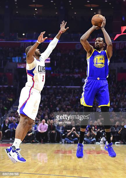 Kevin Durant of the Golden State Warriors shoots a jumper in front of Chris Paul of the LA Clippers at Staples Center on December 7 2016 in Los...