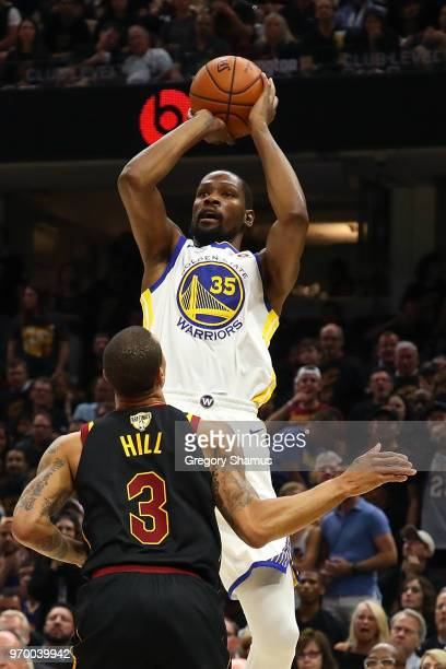 Kevin Durant of the Golden State Warriors shoots a jumper over George Hill of the Cleveland Cavaliers in the first half during Game Four of the 2018...