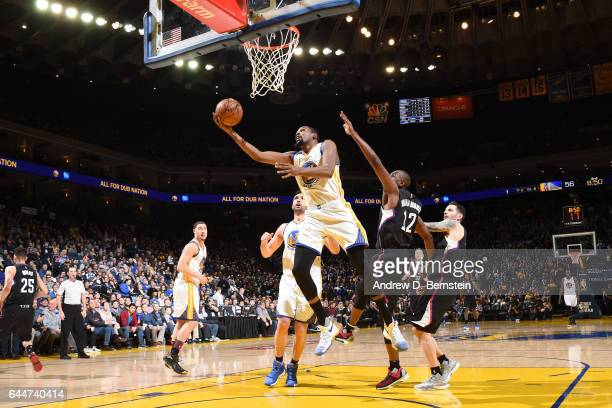 Kevin Durant of the Golden State Warriors shoots a lay up against the LA Clippers during the game on February 23 2017 at ORACLE Arena in Oakland...