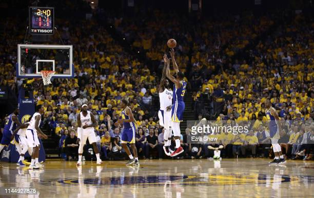 Kevin Durant of the Golden State Warriors shoots a threepoint basket over JaMychal Green of the LA Clippers during Game Five of the first round of...